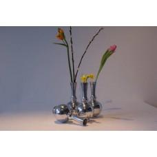 A beautiful polished aluminum Ball vase